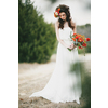 Romantic-fall-bride-poses-outside-with-rich-red-bouquet.square