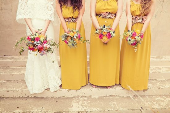 Bride in Lace Wedding Dress with Bridesmaids in Mustard