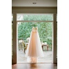 Brides-ivory-wedding-dress-hangs-in-window.square