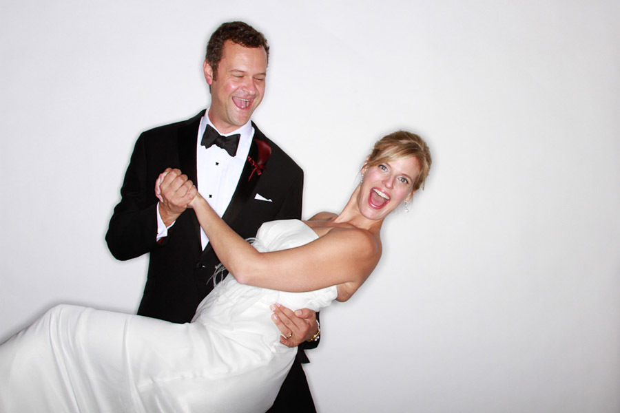 Great Wedding Reception Photo Booth Moments Groom Dips Bride