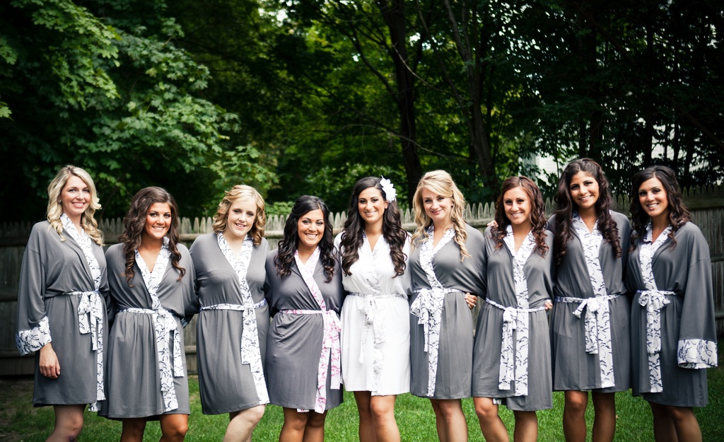 Bride-poses-with-bridesmaids-in-eco-friendly-robes.full