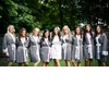 Bride-poses-with-bridesmaids-in-eco-friendly-robes.square