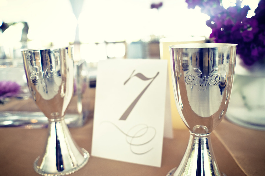 Metallic-wedding-reception-details-bride-groom-toasting-cups.full