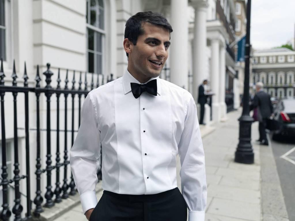 Dapper-black-tie-groom-with-shirt-studs.full