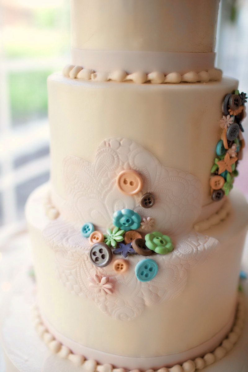Classic-ivory-wedding-cake-lace-and-button-embellished.original