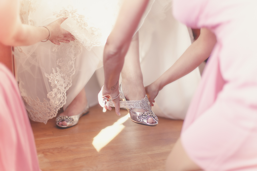 Bride-gets-ready-with-help-from-bridesmaids.full