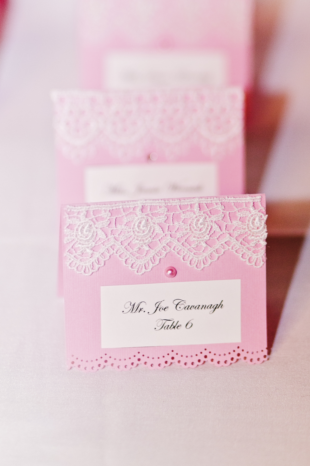Romantic-pink-escort-cards-with-lace-applique.full