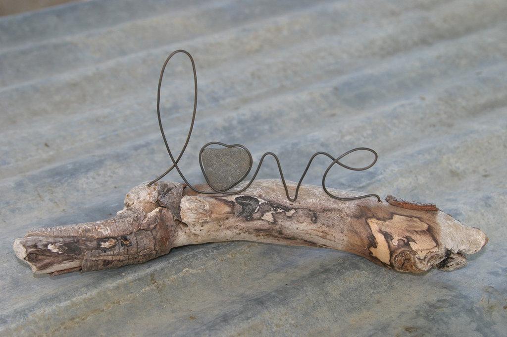Unique-wedding-centerpiece-love-on-driftwood.full