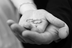 Holding_wedding_rings_s.full