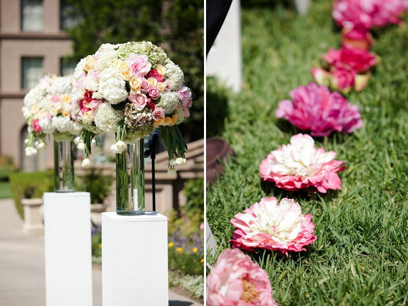 Outdoor Wedding Ceremony With Romantic Flowers Lining The