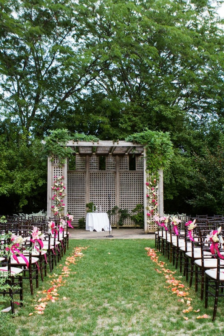 Outdoor Wedding Ceremony with Romantic Arbor and Flowers