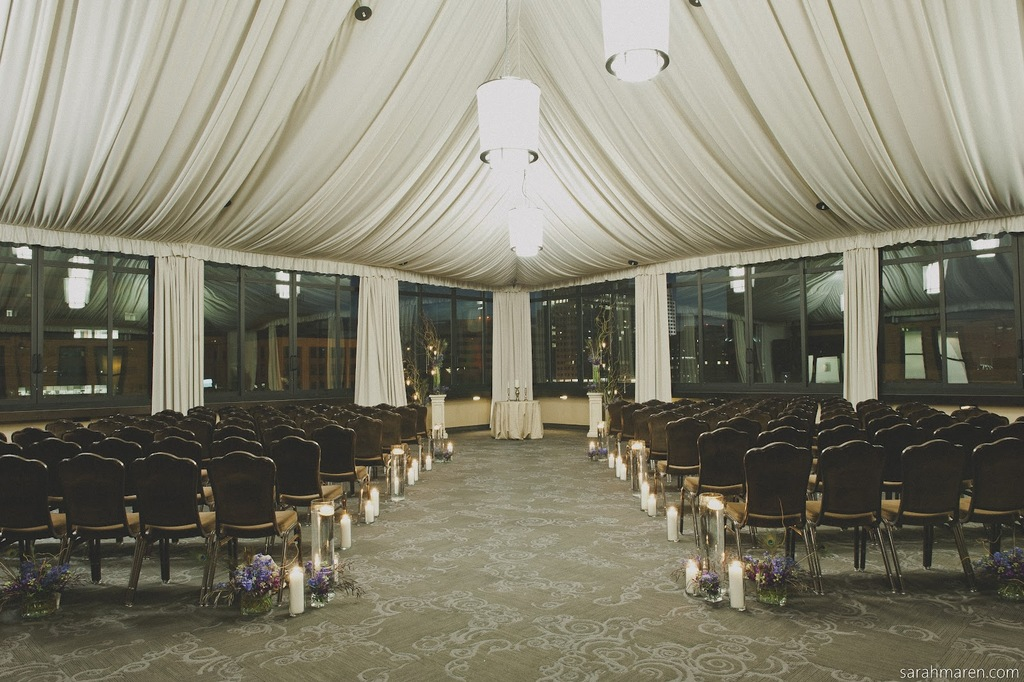 Elegant Drapery At Indoor Ceremony: Elegant Wedding Ceremony Room With Candles Lining Aisle