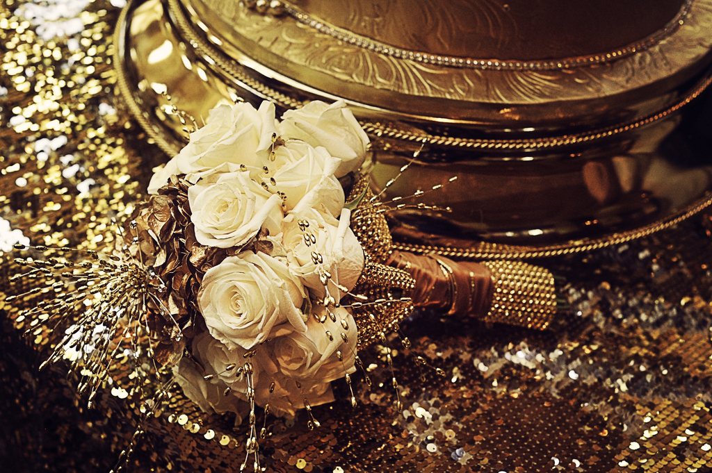 Ivory-bridal-bouquet-with-sparkly-gold-backdrop.full
