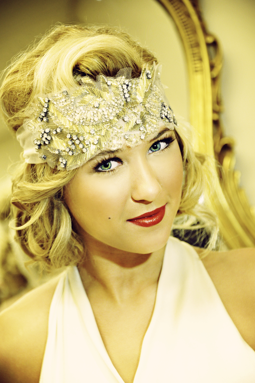 vintage bride with embellished headband and bright red lips full