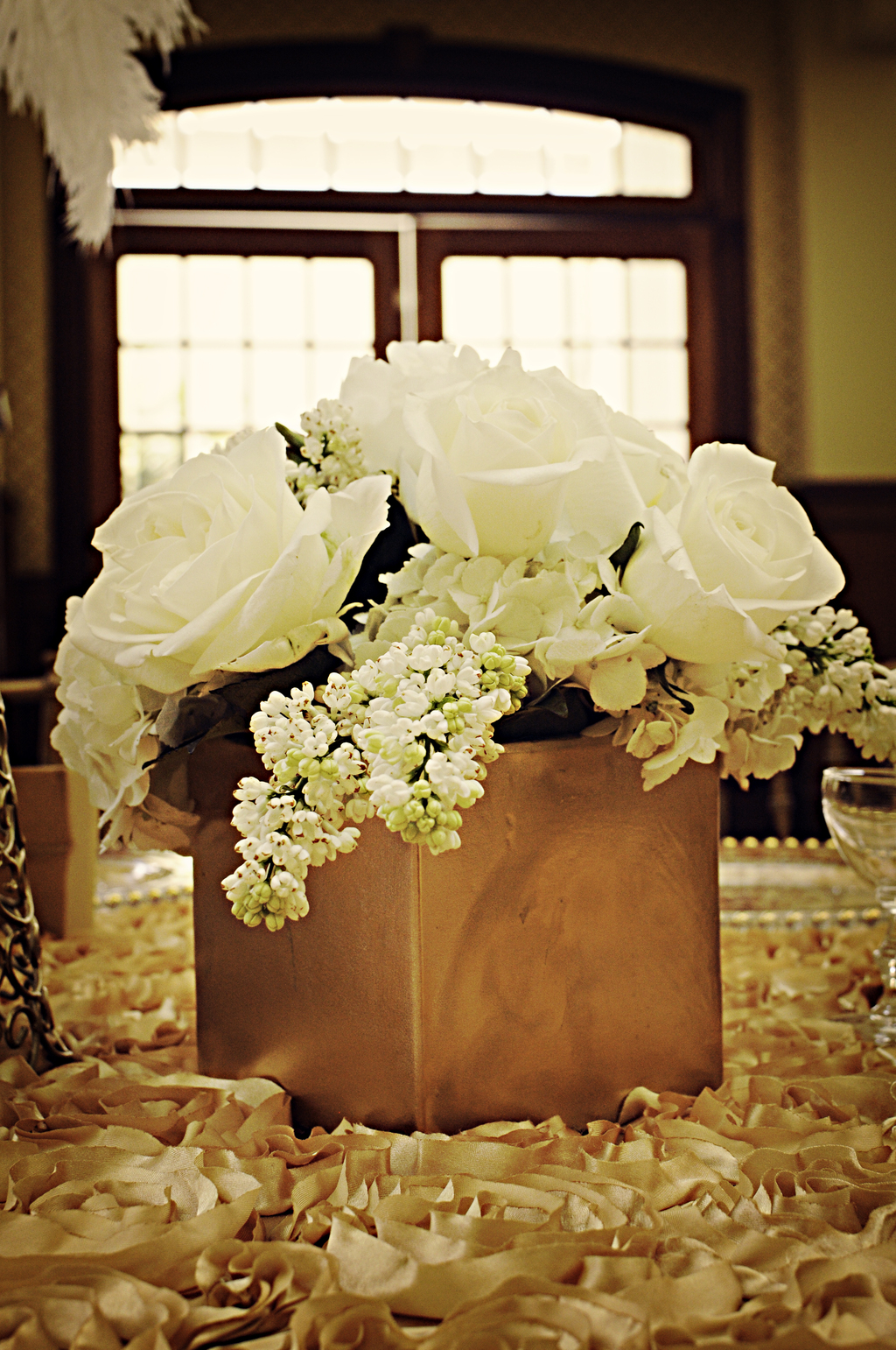 Classic-low-wedding-centerpiece-with-ivory-roses-and-hydrangeas.full