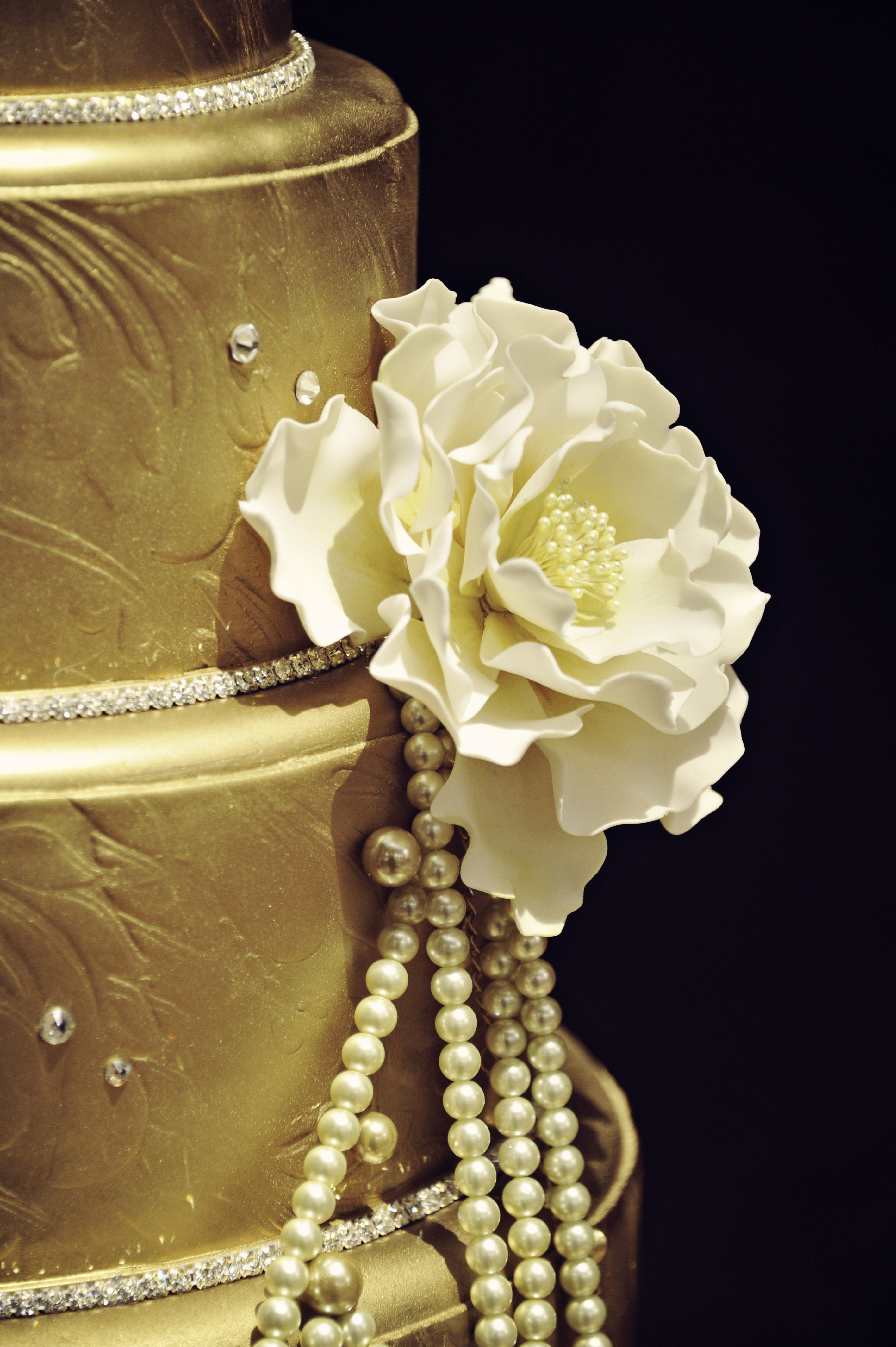Wedding Cake Detail Shot Gold Pearls and Crystals