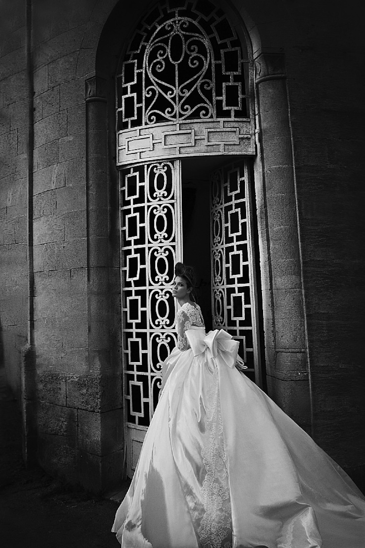 Opulent-wedding-dress-with-sheer-lace-sleeves-and-oversize-bow.full