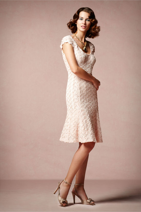 Blush wedding reception dress with rosette applique