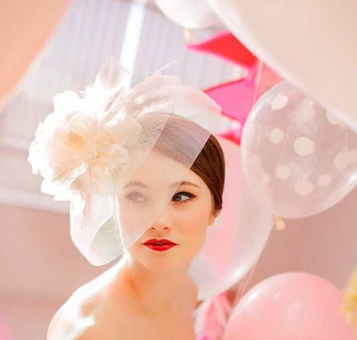 Beautiful-bride-with-bright-red-lips-whimsical-headpiece.full