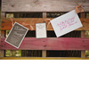 Wedding-invitations-hang-on-rustic-fence.square