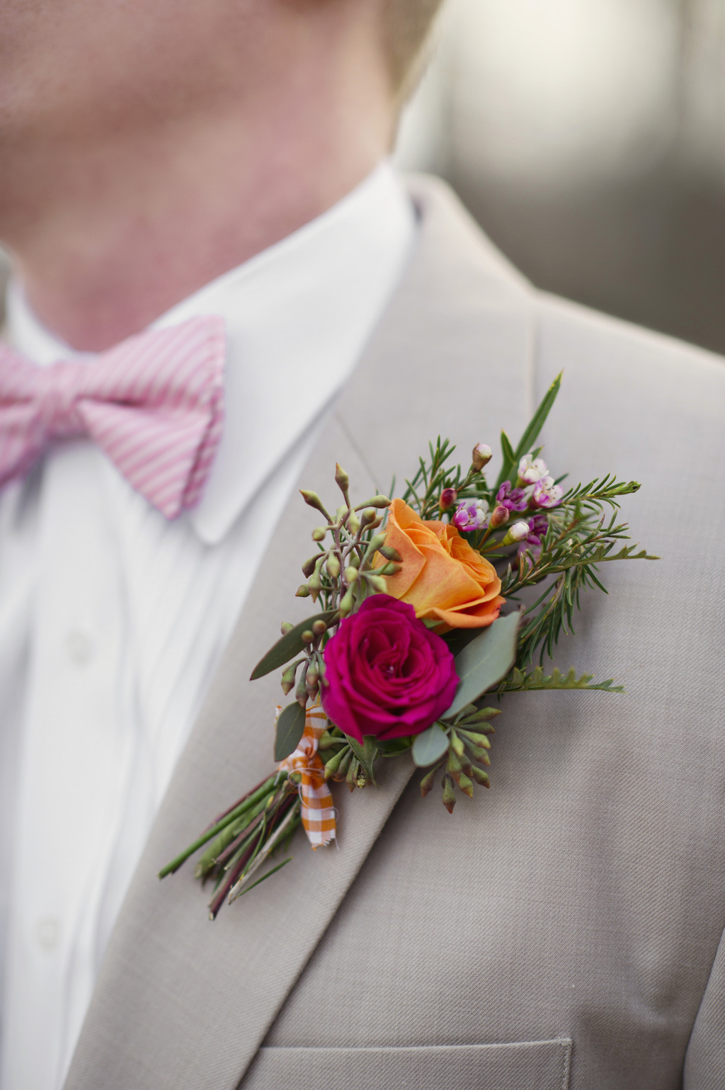 Orange-and-fuschia-grooms-boutonniere.full