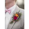 Orange-and-fuschia-grooms-boutonniere.square