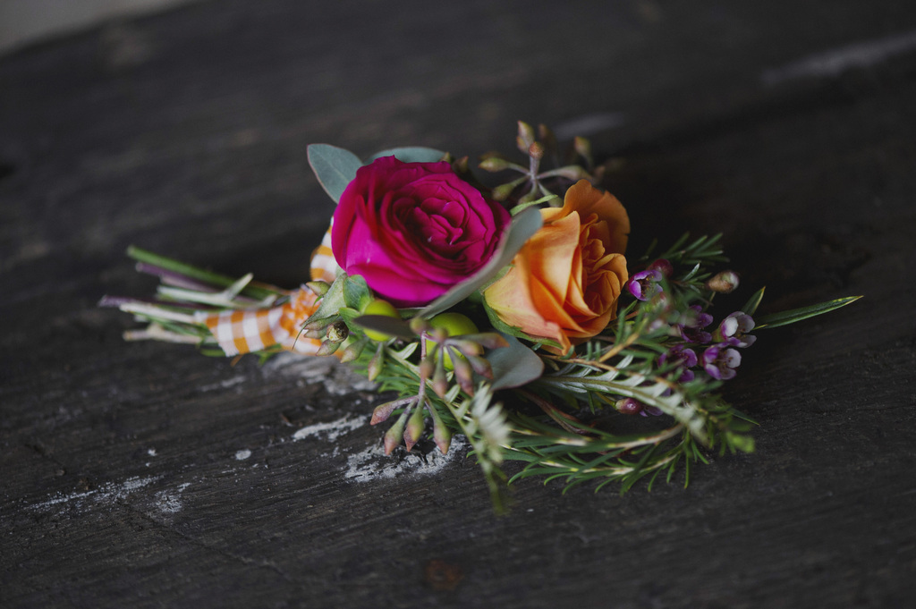 Rustic-romance-grooms-boutonniere-hot-pink-orange-roses.full