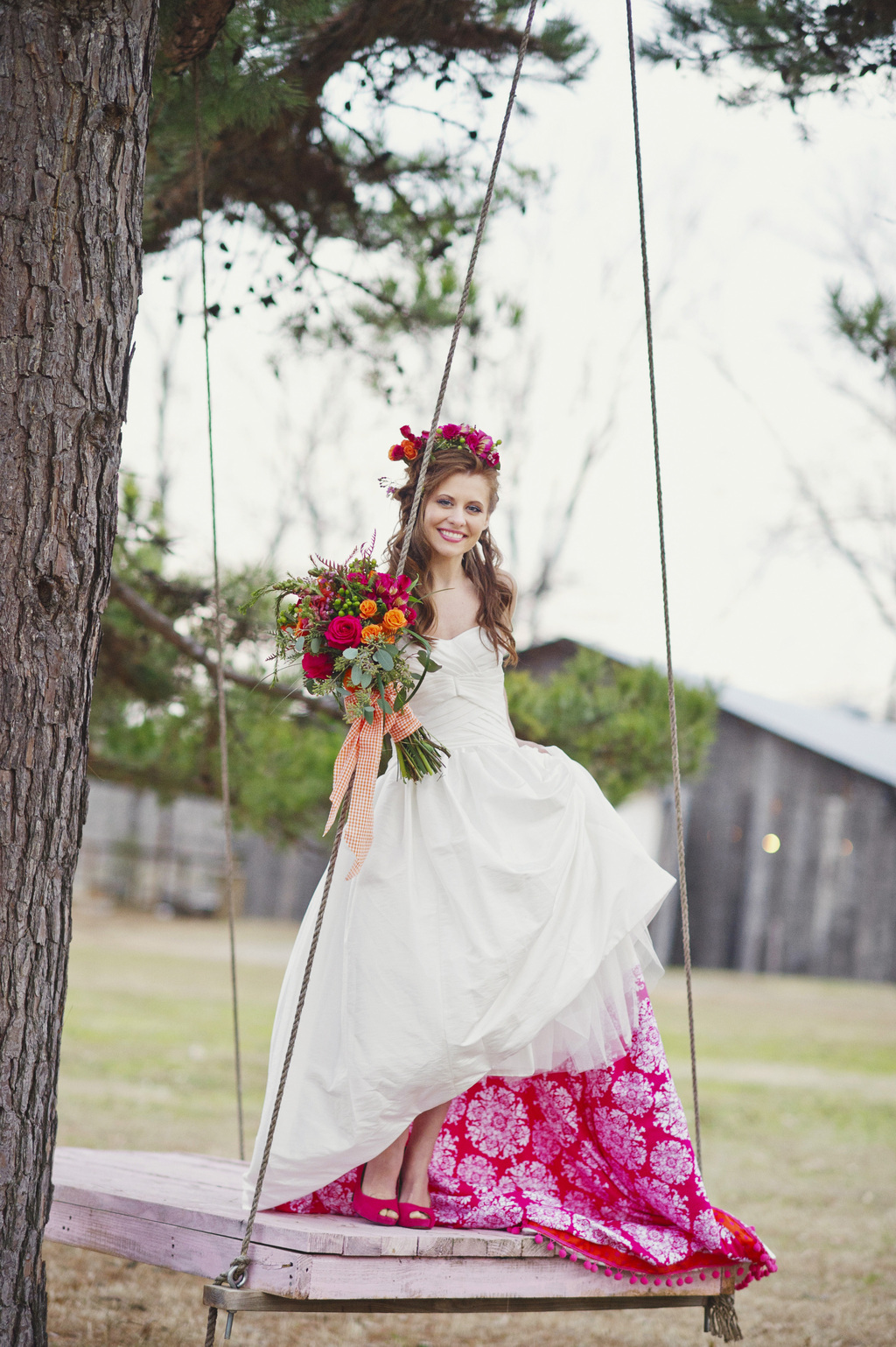 Romantic-bride-poses-on-swing-shows-off-pink-petticoat.full