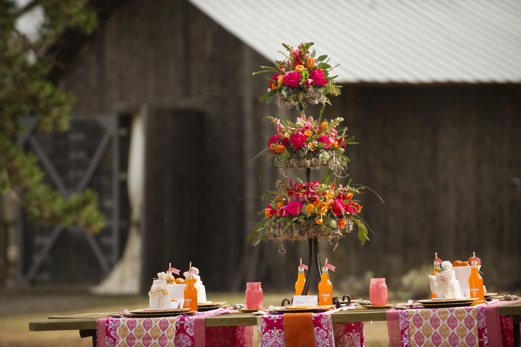 Outdoor-rustic-wedding-reception-bright-decor-accents.full
