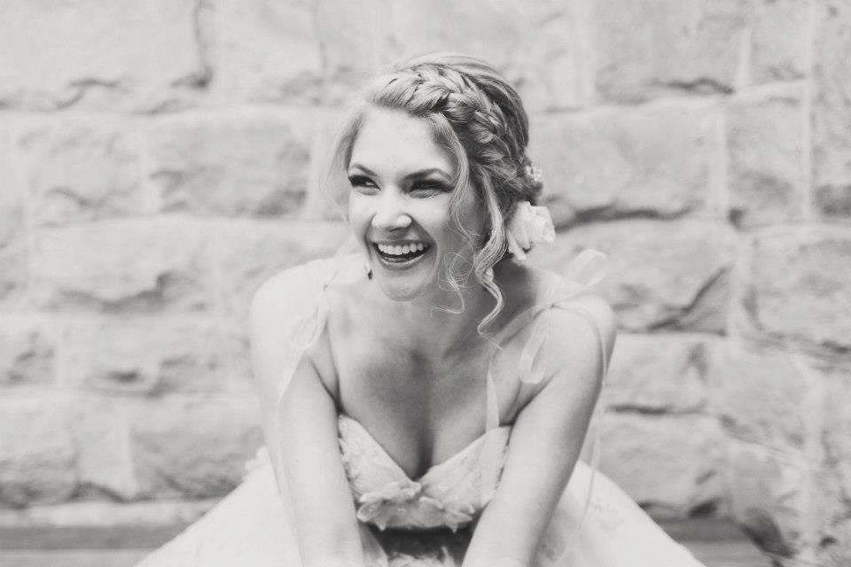 Romantic-braided-wedding-hairstyle-with-curly-tendrils.full