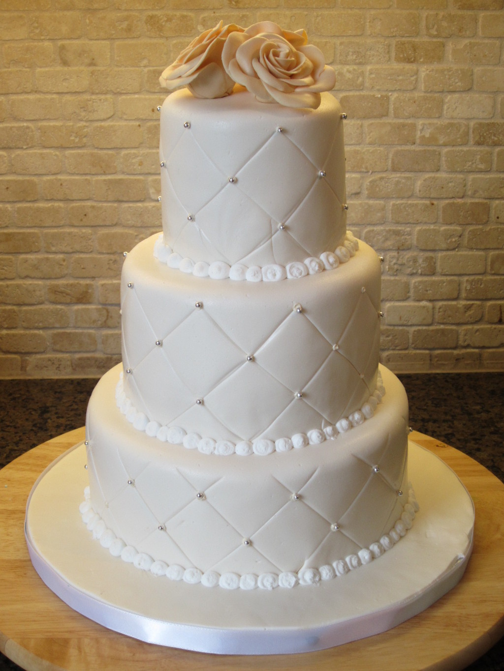 Ivory White Qulited Rose and Silver Pearl Wedding Cake