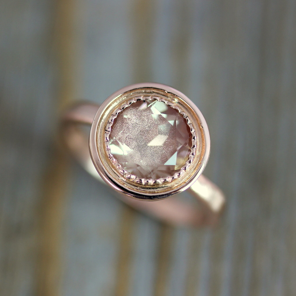 Rose-gold-halo-engagement-ring.full