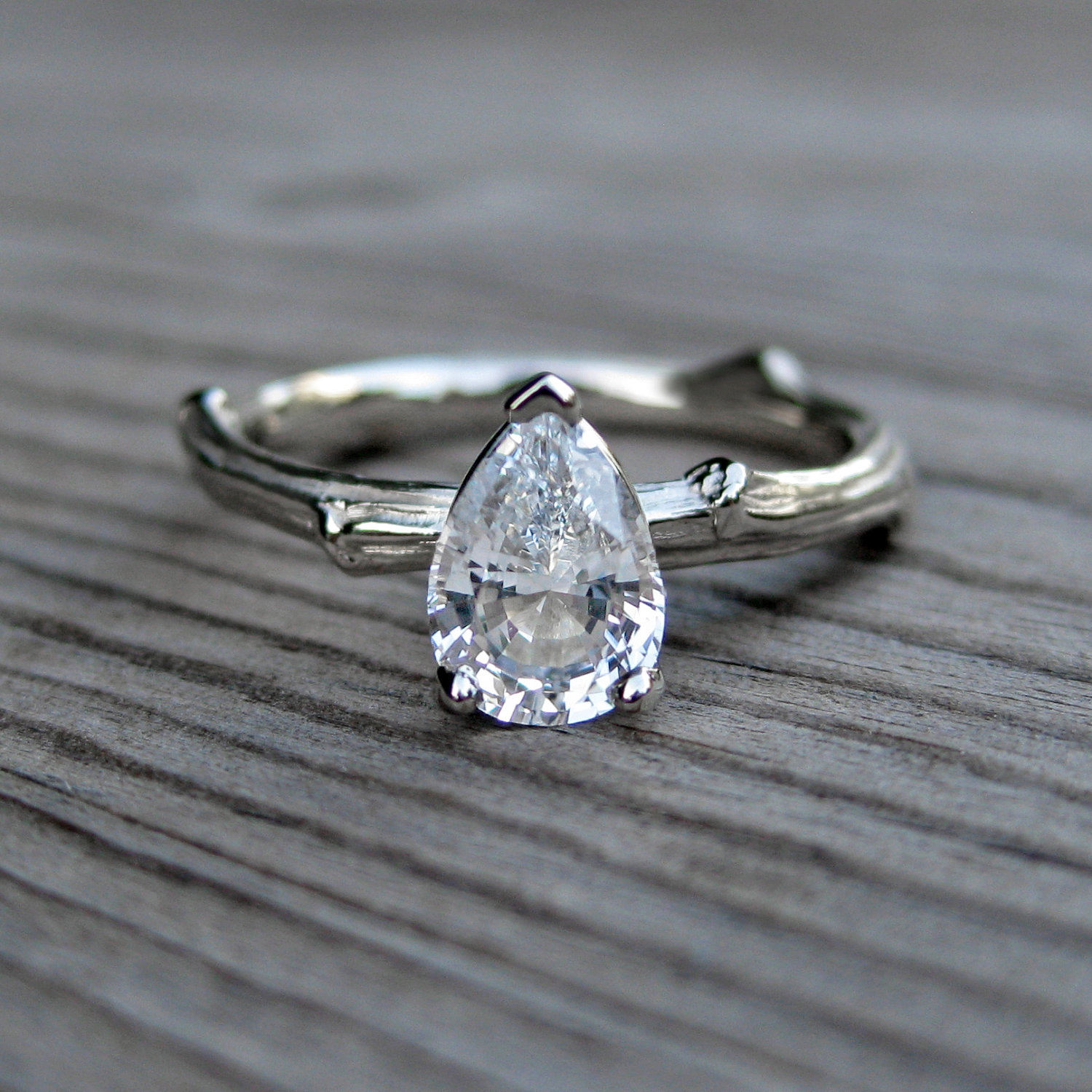 pear shaped white sapphire engagement ring onewed