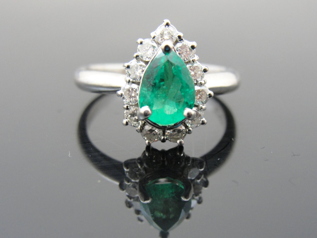 Emerald-engagement-ring-with-diamond-halo.full