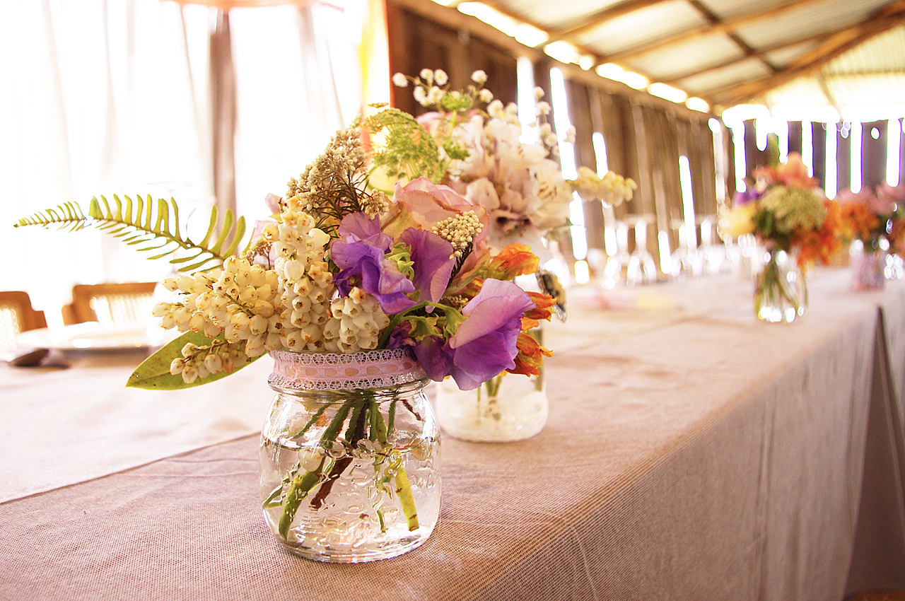 Country rustic wedding reception floral centerpieces