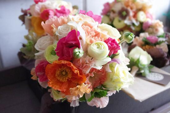 photo of Vibrant Romantic Bridal Bouquet Poppies Ranunculus