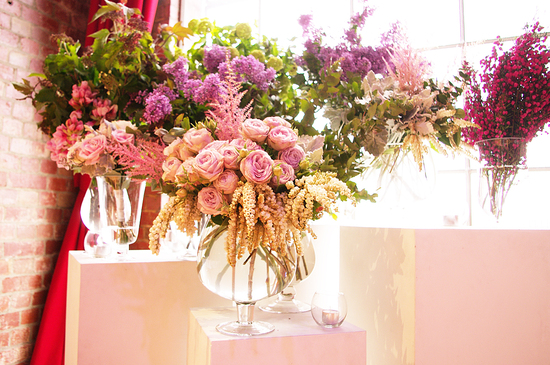 photo of Whimsical wedding flower centerpieces pink roses assorted blooms