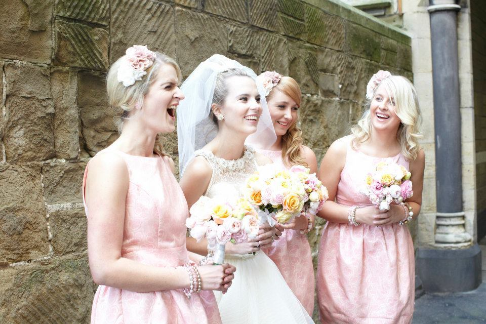 Elegant bridesmaids in pink with romantic bouquets