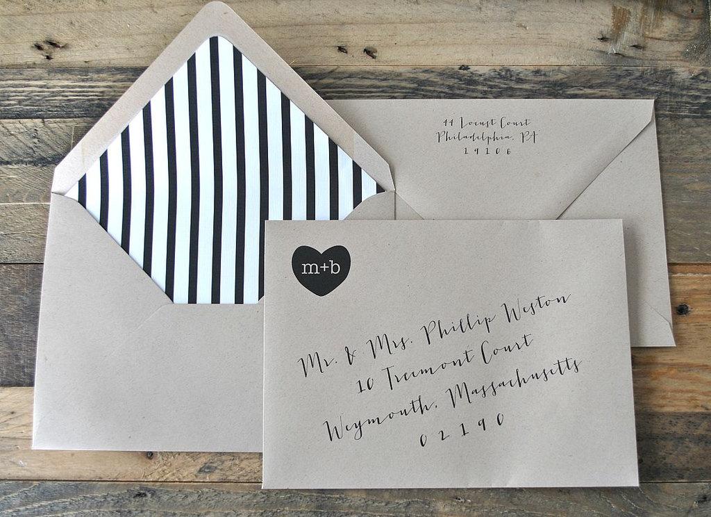 Kraft-paper-wedding-envelopes-with-black-and-white-stripe-liner.full