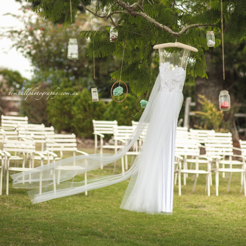 Illusion Neckline Wedding Dress Hangs from Tree