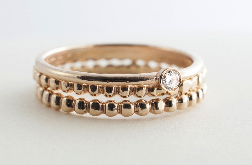 Stackable gold wedding bands with single diamond