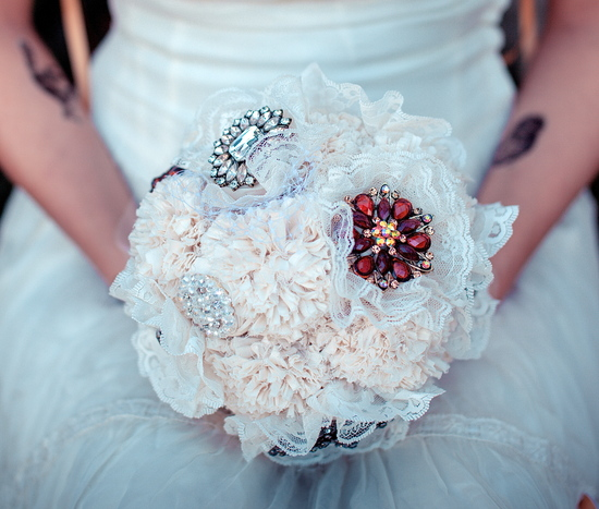 Alternative bridal bouquet with lace and vintage brooches
