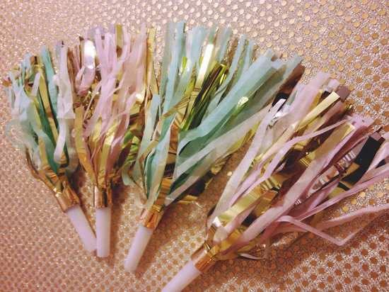 pastel and gold noise makers for NYE wedding