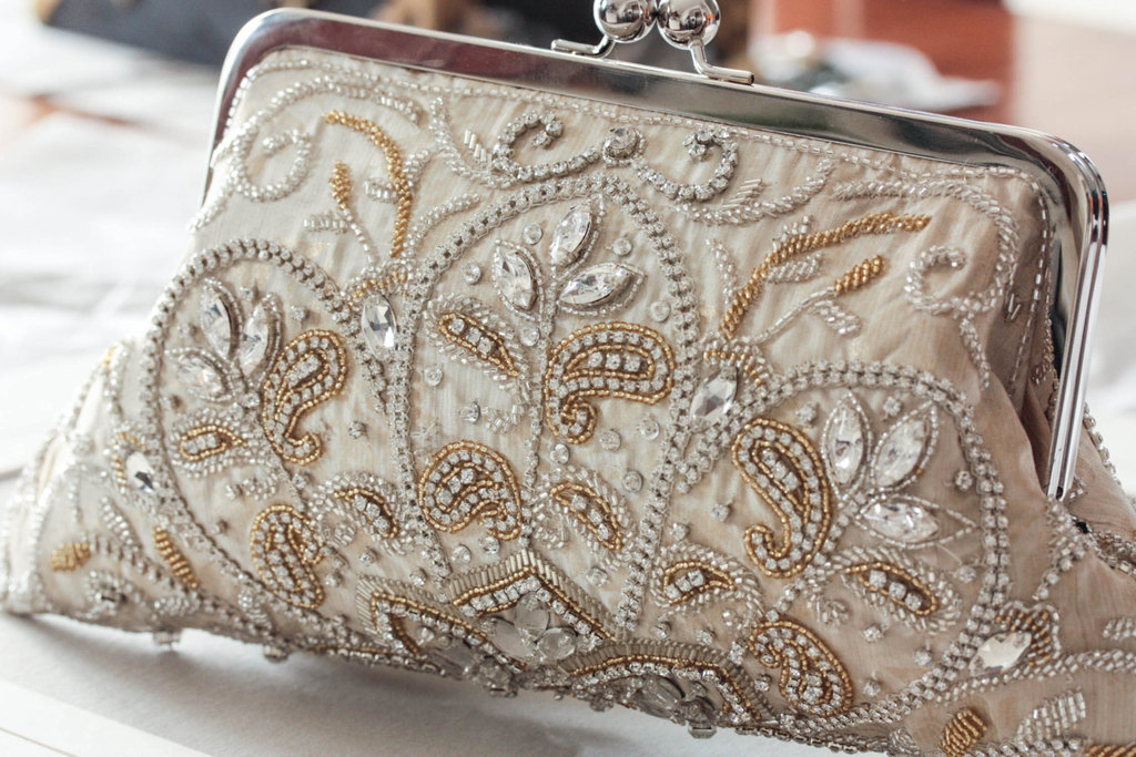 Ecru beaded bridal clutch with elegant embroidery