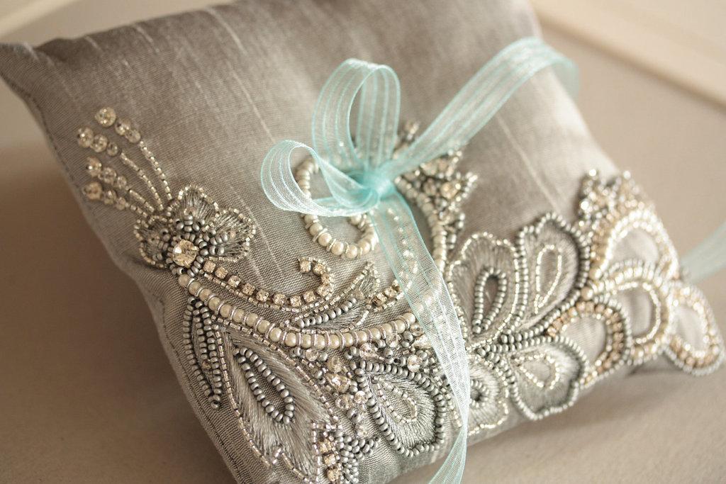 silver beaded ring bearer pillow with aqua ribbon