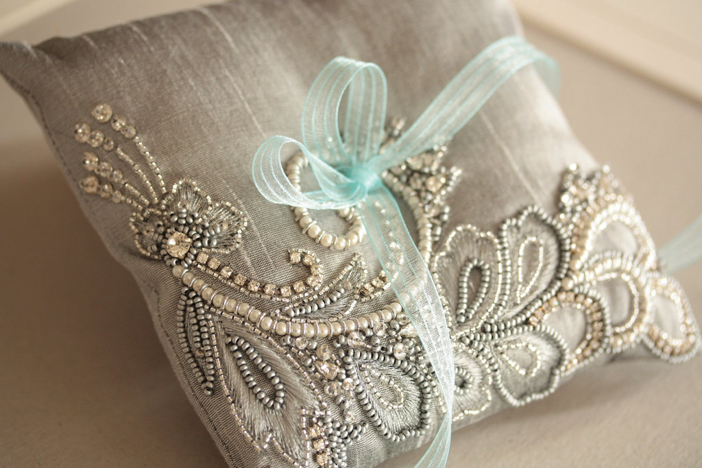 Silver-beaded-ring-bearer-pillow-with-aqua-ribbon.full