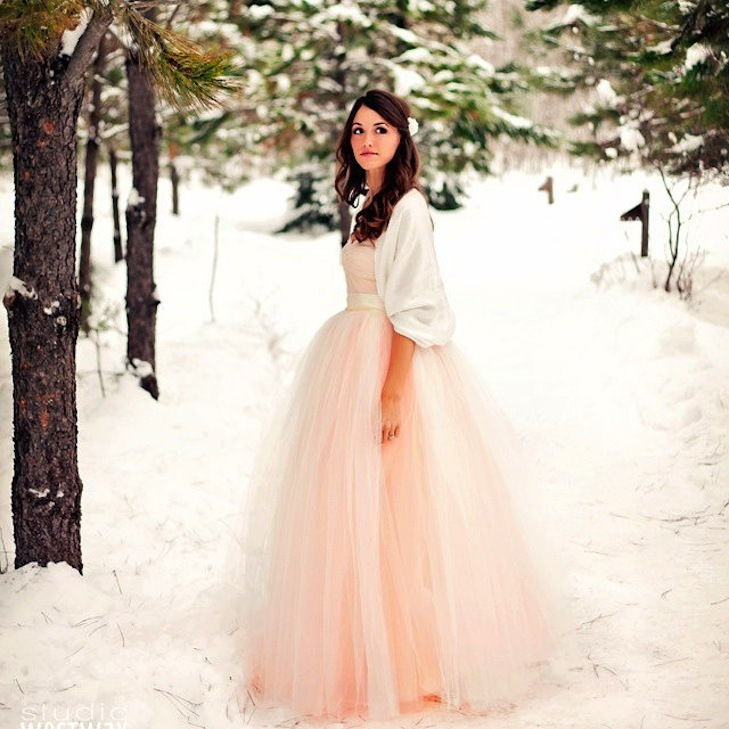 Light pink wedding gown with cream bolero