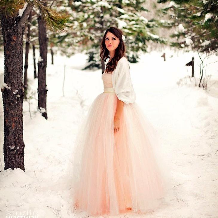 Light-pink-wedding-gown-with-cream-bolero.full