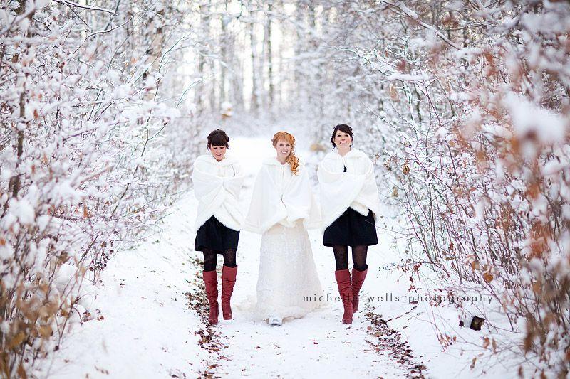 Winter-bride-walks-through-snow-with-bridesmaids.full
