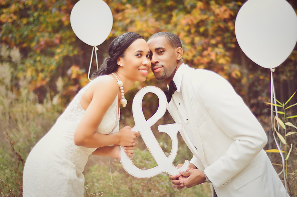 Classic bride and groom pose with whimsical reception decor
